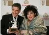 Host Craig Ferguson and honoree Dame Elizabeth Taylor meet on the red carpet