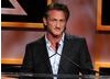 Actor Sean Penn delivers a speech on stage during the Britannia's ceremony