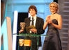 Jesse Eisenberg (The Social Network) and Jennifer Lawrence (Winter's Bone) announce the Special Visual Effects winner. (Pic: BAFTA/ Stephen Butler)