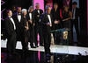 Jonathan Young, Tim Key and Kevin Rundle joined The Bill cast memebers Amita Dhiri (DC Grace Dasrai) and Chris Simmons (DC Mickey Webb) on stage to accept the Continuing Drama BAFTA - the first time the soap has won the award (BAFTA / Marc Hoberman).