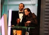 Tom Ford (director, A Single Man) and Eva Green (Casino Royale) announce Inception and Bronson star Tom Hardy as the Orange Wednesdays Rising Star. (Pic: BAFTA/ Stephen Butler)