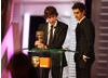 The Social Network co-stars Jesse Eisenberg and Andrew Garfield accept David Fincher's BAFTA on his behalf. 