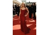 This stunning, deep red gown is well fitted, but does not over-reveal due to the delicately ruched fabric on the bust and hips. The belted waist and low skirt flare both help to enhance her curvy figure and give a beautiful silhouette. Patsy has chosen not to accessorise this dress because it is striking enough on its own.  When picking a gown in a statement colour, be careful not to over embellish it with accessories. Keep them classic to complement your dress.