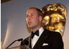 BAFTA's President - watched over by the iconic BAFTA mask - addresses the star-studded crowd.