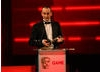 Colin Blackwood from Electronic Arts accepts the BAFTA for Audio Achievement.