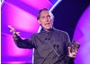 Director and screenwriter Henry Selick celebrates winning the Feature Film BAFTA for his adaptation of Neil Gaiman's book, Coraline