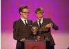 Band members Tom Fletcher and Dougie Poynter of McFly share the stage to present the award for Entertainment.