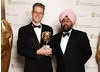 Joby Gee celebrates his Editing Factual win for The Fallen with comedian Hardeep Singh Kohli (BAFTA / Richard Kendal).