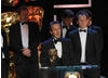 BBC Two's tribe presenter Bruce Parry was joined on stage by Steve Robinson and Sam Organ to accept the Factual Series award for the documentary series Amazon with Bruce Parry (BAFTA / Marc Hoberman).