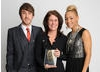 Disney's Tricia Wilber with the BAFTA Kids' Vote award for TV show Good Luck Charlie, plus presenters Kye Sones & Jade Ellis (The X Factor).