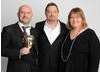 Presenter Eddie Izzard with CBBC's Cheryl Taylor and Damian Kavanagh.