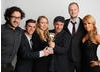 Presenter Aliona Vilani with the winning team behind Seeking Refuge, including Andy Glynne.