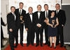 The X Factor team celebrate winning the Factual Series Award with citation reader Robert Webb ( BAFTA/Richard Kendal)