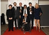 The IT Crowd team with citation readers Micheal McIntyre and Tess Daly celbrate their win in the Situation Comedy category for The IT Crowd (BAFTA/ Richard Kendal).