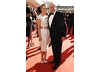 Spooks stars Miranda Raison looked demure next to co-star Peter Firth in a cream dress by Reiss (BAFTA/Richard Kendal).