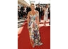 Lucy Benjamin takes the red carpet walk in a long floral dress by Matthew Williamson matched with Christian Louboutin shoes and QVC jewellery  (BAFTA / Richard Kendal).