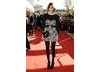 Fashonista Alexa Chung looked simply stunning in a short Luella dress accesorised with an oh-so-cat kitten bag (BAFTA/ Richard Kendal). 