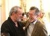 Terry Gilliam and John Hurt catching up at the special BAFTA event at Savoy, London.