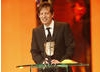Slumdog Millionaire's producer Christian Colson accepts the Best Film BAFTA, the film's seventh BAFTA of the night (BAFTA / Marc Hoberman).