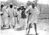 At 61 Gandhi begins the long march to the sea at Dandi to gather salt.