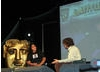 Gurinder Chadha and Alan Davies on stage at Latitude Festival 2008. 
