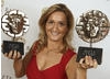 Lowri Morgan with her two BAFTA Cymru Awards for Best Presenter and Best Factual Series 
