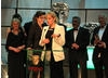 Presenters Mary Berry, Sue Perkins, Mel Giedroyc and Paul Hollywood are among the team accepting the Features BAFTA.