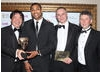Presenter Delon Armitage with with Joe Wee, Andy Needham and Chris Byatte from publisher Chillingo, collecting the BAFTA on behalf of Efim Voinov, Semyon Voinov of Zeptolab whose work on the physics-based title for iOS was praised by the jury for its challenging and novel gameplay. (Pic: BAFTA/Steve Butler)