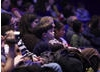 A young Merlin fan listens attentively to the demonstration of the show's music (BAFTA / Jonny Birch).