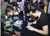 Actress Kaite McGrath signs autographs for young fans after the event (BAFTA / Jonny Birch).