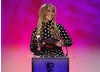 Heidi Range, of the Sugar Babes, reads the nominations (Steve Backshall, Justin Fletcher, Kemi Majeks, Helen Skelton) and winner of the Presenter category.