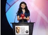Kelly Brook presents the Kids' Vote award at the British Academy Childrens' Awards