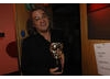 Paul Greengrass backstage with his BAFTA for directing United 93 (BAFTA / Liam Daniel).