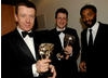 Chiwetel Ejiofor (right) with Peter Morgan and Jeremy Brock, winners of the BAFTA for Adapted Screenplay for The Last King of Scotland (BAFTA / Liam Daniel).