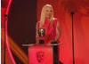 The multi-talented comedienne, presenter and clinical psychologist presents the award for Original Music. (Pic: BAFTA/Jamie Simonds)