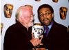 Richard Attenborough presents a Special Award to director Spike Lee in 2002.