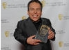 Professor Flitwick in the Harry Potter series Warwick Davis with the award for the final film, which won after more than 400,000 7-14-year-olds went to www.baftakidsvote.org to cast their votes.
