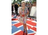 The Shameless and Brookside actress arrives on the union jack carpet.