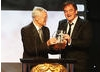 Roger Corman presenting Quentin Tarantino with the Britannia Award for Excellence in Directing.