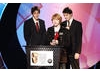 Rupert Grint (front) and James and Oliver Phelps, aka The Weasleys, collect the Kids' Vote award for Harry Potter and the Goblet of Fire