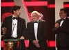 David Attenborough, Anthony Geffen and Sias Wilson accept the award for Flying Monsters 3D.
