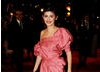 Audrey Tautou, Leading Actress nominee for Coco Before Chanel arrives on the red carpet in a striking pink dress (BAFTA/Richard Kendal).