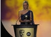 The Gadget Show presenter announces the Video Game winner. Pic: BAFTA/Steve Finn