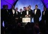 The team at Rocksteady Studios, creators of Batman: Arkham Asylum, take to the stage for the second time in the evening to accept the coveted award of Best Game (BAFTA/Brian Ritchie)