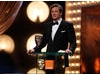 Colin Firth, nominee in the Leading Actor category for A Single Man, presents the first award of the evening, for Outstanding Debut by a British Writer, Director or Producer (BAFTA/Brian Ritchie)
