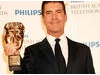 Simon Cowell poses with his Special Award BAFTA (BAFTA/Richard Kendal).