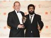Four Lions actors Nigel Lindsay and Adeel Akhtar collect Chris Morris' BAFTA. (Pic: BAFTA/Richard Kendal)