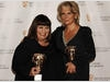 Dawn French and Jennifer Saunders celebrate receiving the Academy's highest honour, the Fellowship, at the British Academy Television Awards (BAFTA/ Richard Kendal).