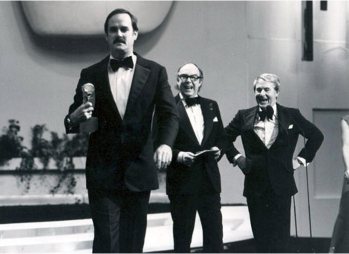John Cleese wining an award presented to him by Morecambe and Wise
