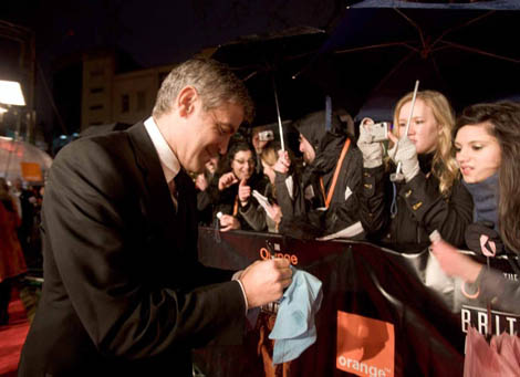 George Clooney greets the fans on the Film Awards red carpet.